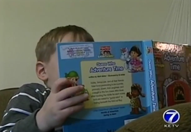 autistic patient calmy reading book after chiropractic care