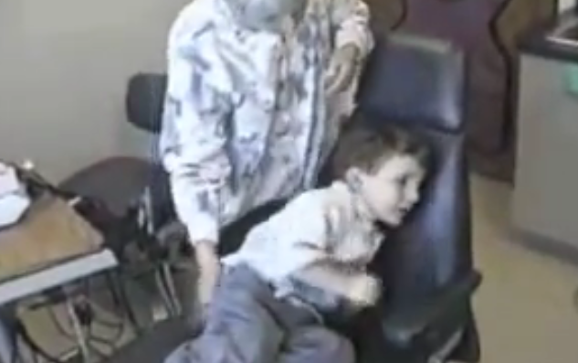 autistic child struggling in dental chair